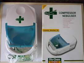 Nebulizer. Never been used. In a box with Brand new  set of Masks - on