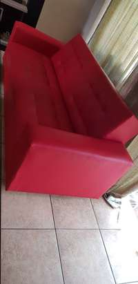 Red 3 seater sleeper coach. Still in perfect condition fairly used. 0