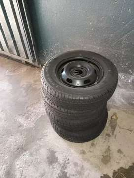 Renault Kwid  4new orginal tyres and rims for sale