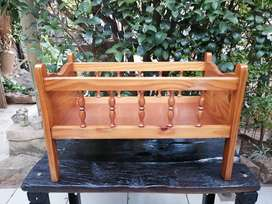 Beautiful solid pine kids doll cot.