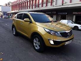 Kia sportage yellow in color with leather interior