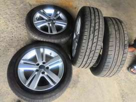 A set of original 15 inch Rims with good tyres for polo
