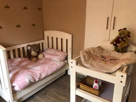 Large cot and changing table for sale