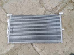 Радиатор кондиционера FORD.