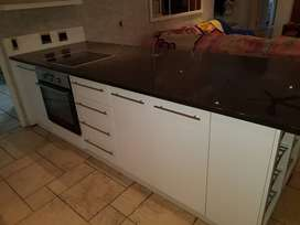 Samsung Stove and Oven Set with Granite Counter Tops and Cabinets