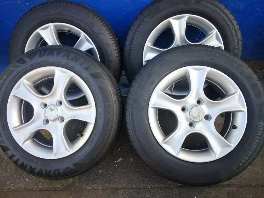 A set of 14inch mags and tyres 4/100 pcd