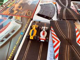 Two Scalextric Sets. Racing track and cars.