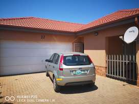 An elegant and spacious 3 bedroom towhnhouse in a secure complex.