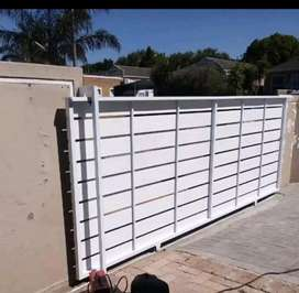 GALVANIZED STEEL FRAMED NUTEC CLADDED GATES AND FENCING