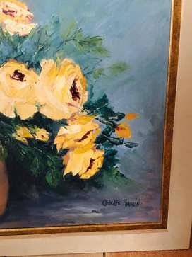Large oil painting of flowers in a vase