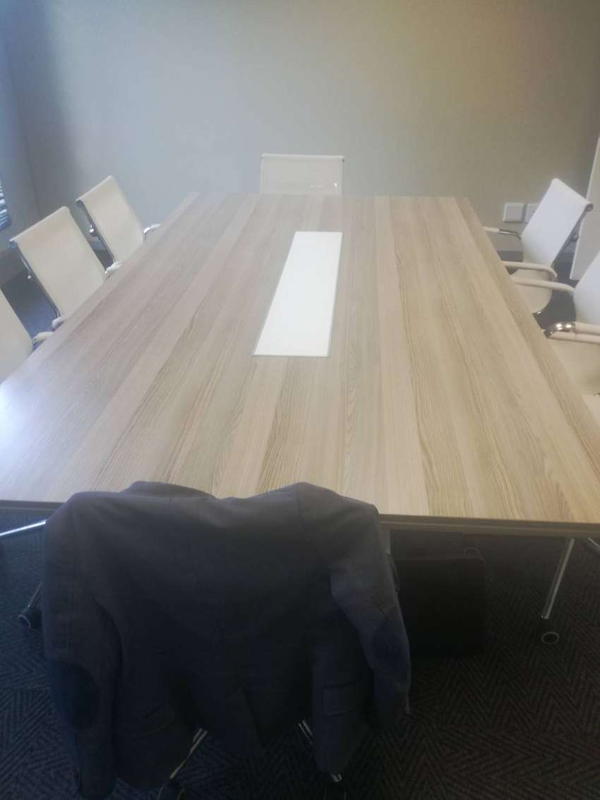 Boardroom table and 8 chairs, 4 years 0