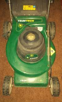 Image of Trim tech lawn mower in mint condition