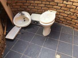 Toilet basin and tap