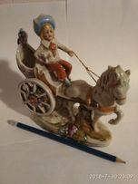Фарфоровая статуэтка. Мальчик в карете на ослике. Германия.