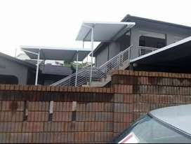 YOU NEED A BEAUTIFUL CARPORT/AWNING OVER THAT SPACE, CONTACT US