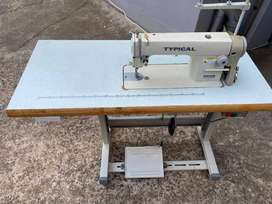 Typical industrial sewing machine