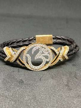 Gold and diamond designer bracelet with leather