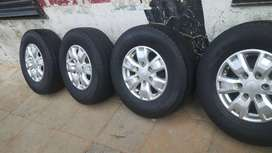 A set original of ford ranger rims and treys for sell