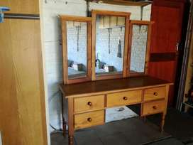 Yellow wood bed frame and dresser