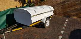 Jurgens trailer with lawnmowers and weetheaters for sale