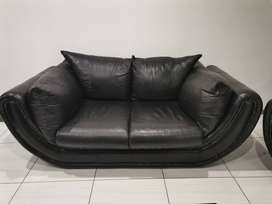 2 seater couch and 1 seater genuine leather couches from Truewood Furn