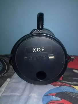 Bluetooth speaker XQF with a charger