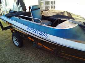 Boat for Sale with Johnson Engine 70 hp and boat trailer