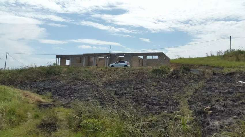 Land and house (price negotiable)
