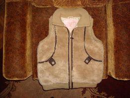 Продам женскую жилетку б/у из искуственного меха