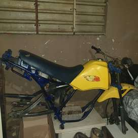 Yamaha frame . With forks, seat and petrol tank.