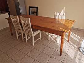 Pinewood dinner table with six cushioned wooden chairs
