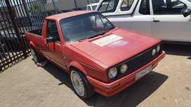 Red 1990 VW Caddy 2.0l