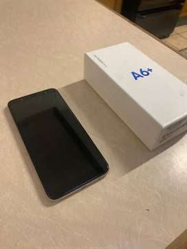 Phone Samsung galaxy A6+ for sale with earphones