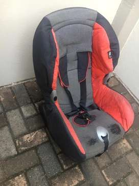 Red and black car seat NEGOTIABLE