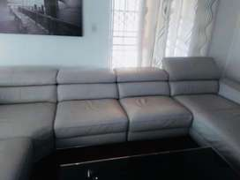 Eight seater couches plus tv 70 plus glass coffe table and red carpet