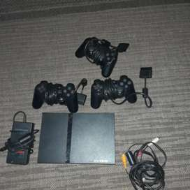 Playstation 2 console and games and dance mat +3 controls