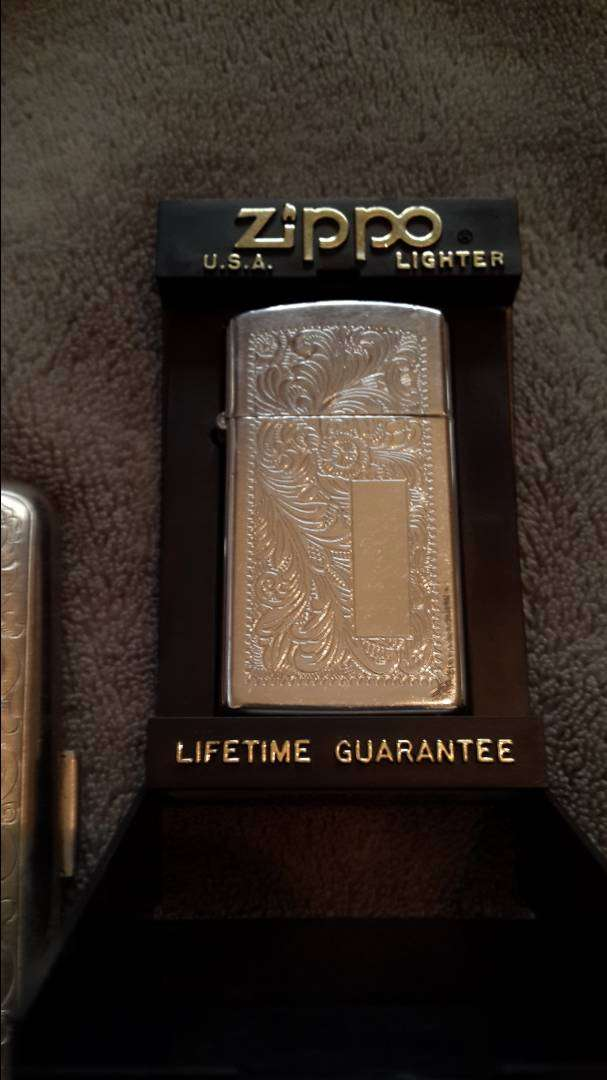 Zippo lighter and silver cigarette casing 0