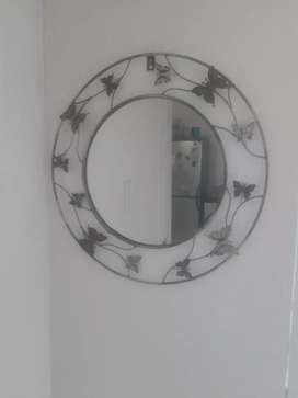 Beatiful round metal mirror with intricate butterfly detail