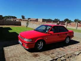 Am selling a red Toyota corolla 1.6 engine capacity 5 speed gear box