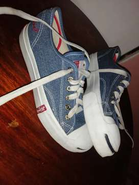 Ladies converse and Levi's shoes