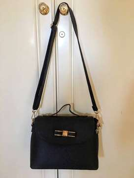 Black Crossbody Bag with Gold Detailing