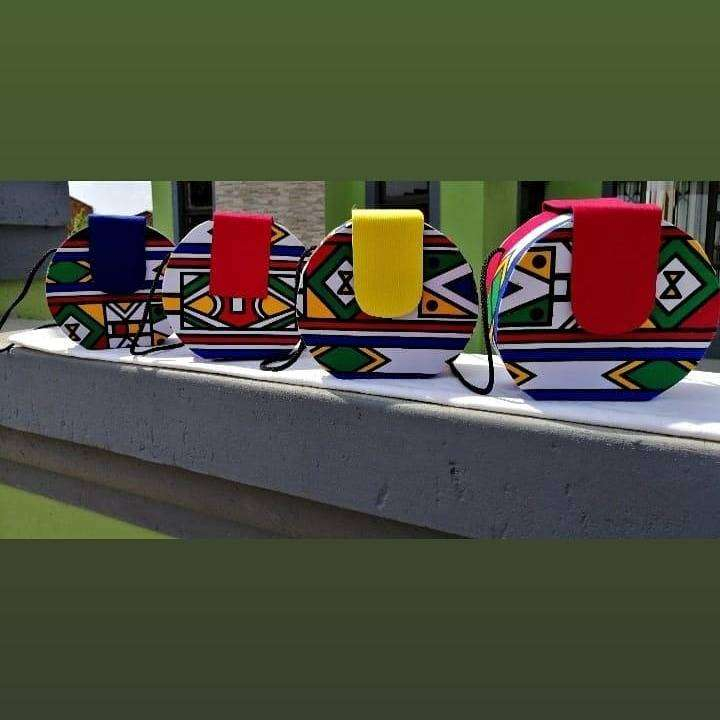 Hi guys I sell ndebele print bags and bucket hats. 0