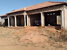 3 room house with double garage but not fully completed..