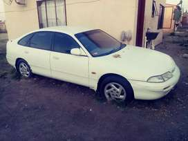 Ford telsta, white in color neat interior with lather seats