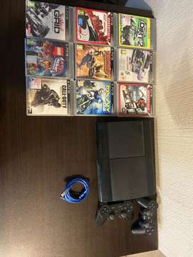 Playstation 3 with Games, Cables and Controllers