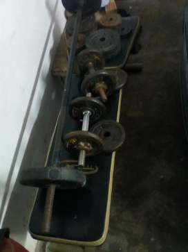 Weights ,long bar, punch in bag ,heavy  duty bench