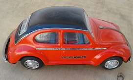 Toy vw beetle made of tin