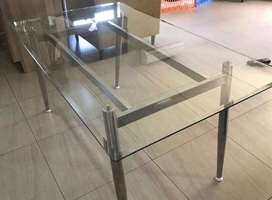 Glass dining room table for sale.