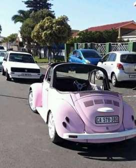 CONVERTIBLE BEETLE PINK IN COLOUR