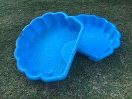 Clam shell pool and sandpit
